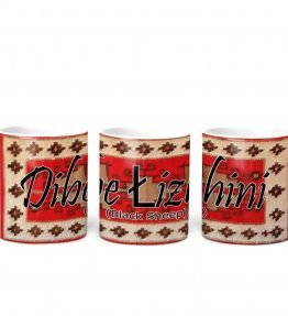 """Dibe lizhini (Black Sheep)"" Navajo Clan with Red Rug Background on 11 Ounce White Coffee Mug"
